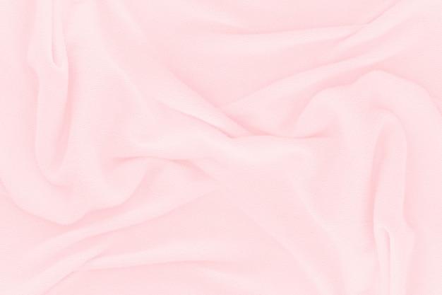 Miękki różowy tkanina tekstura tło. streszczenie tkaniny jedwabne na tapetę lub tło