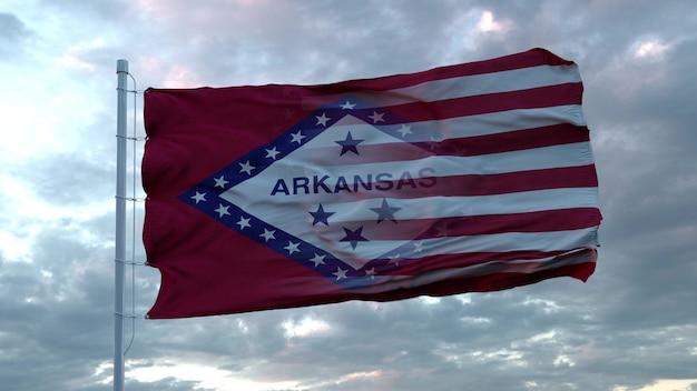 Mieszana flaga usa i arkansas powiewająca na wietrze