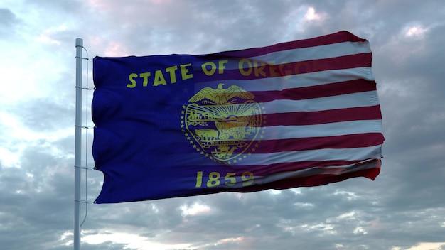 Mieszana flaga usa i oregonu powiewająca na wietrze