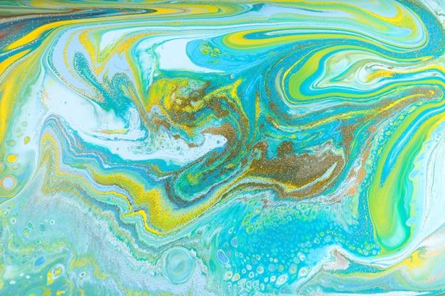 Mieszane kolorowe farby w tle. wylewanie malarstwa.