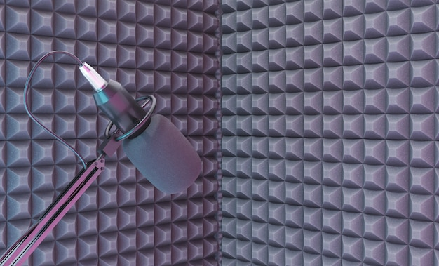 Mikrofon studyjny nad kącikiem do nagrywania z pianką akustyczną