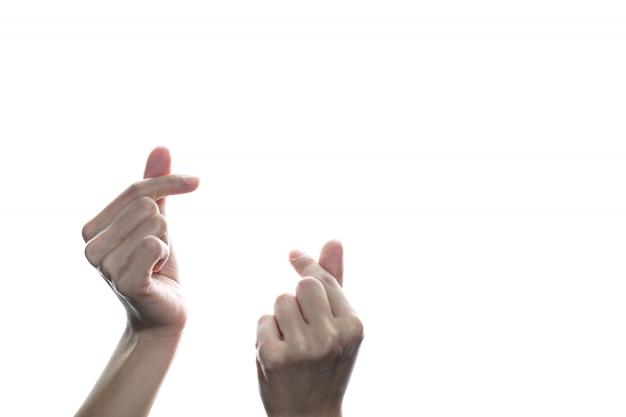 Mini kierowa ręka odizolowywająca na biel ścianie. zarejestruj się w świecie miłości.