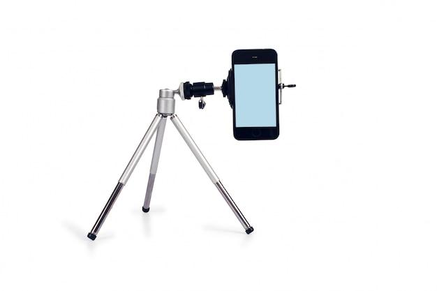 Mini tripot streaming video live z inteligentnym telefonem i narzędziem mikrofonowym.