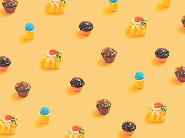 Minimalna koncepcja. modny wzór candy wykonany z różnych cukierków na jasnożółtym tle