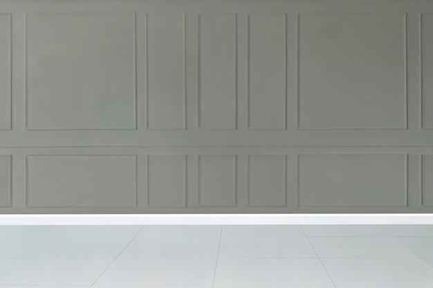 Minimalna makieta pustego pokoju z szarą wzorzystą ścianą