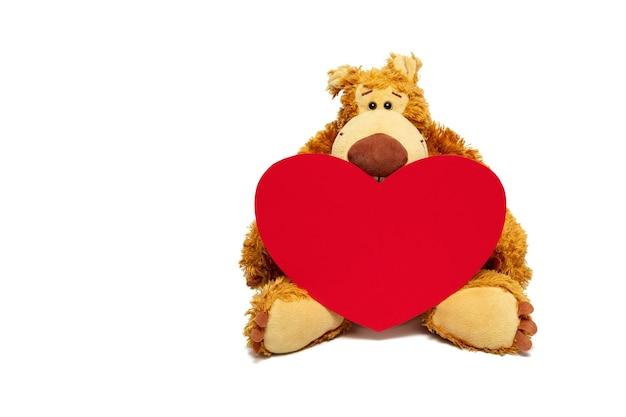 Miś Trzymający Kartonowe Serce Na Walentynki. Widok Z Przodu, Miejsce Na Kopię. Premium Zdjęcia