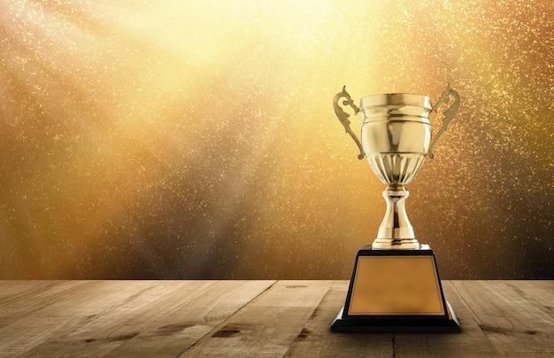 Mistrz złoty trofeum na stole drewna z kopia miejsce i złoto twinkly lights i blask