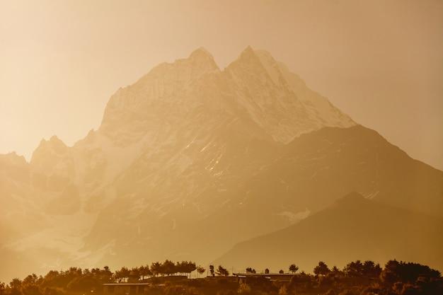 Misty thamserku mountain.