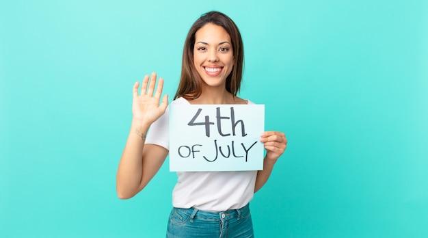 Młoda hiszpańska kobieta uśmiecha się radośnie, macha ręką, wita i wita. koncepcja dnia niepodległości