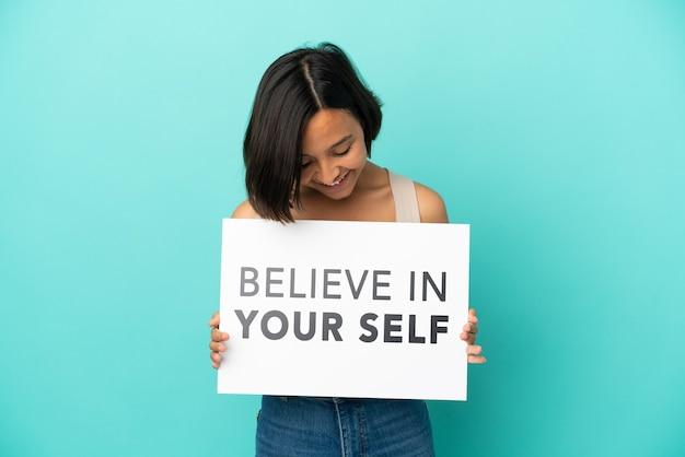 Młoda kobieta rasy mieszanej odizolowana trzymająca deskę we want you