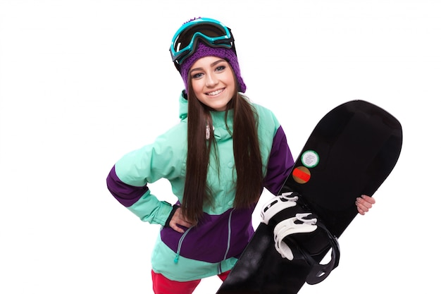 Młoda kobieta trzymać czarny snowboard