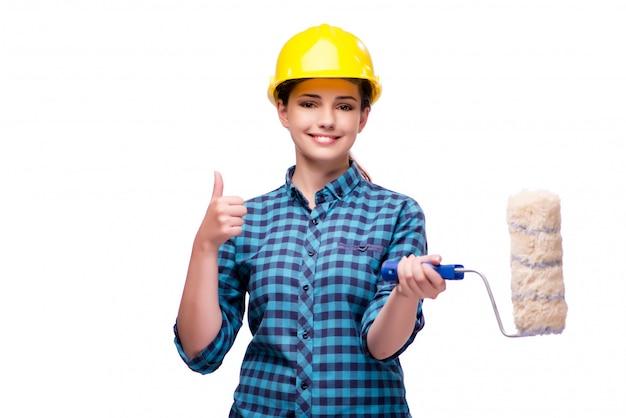 Młoda kobieta w przemysłowym pojęciu odizolowywającym na bielu