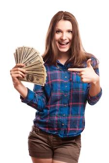 Młoda kobieta z dolarami w jej rękach, odosobnionych na białym tle