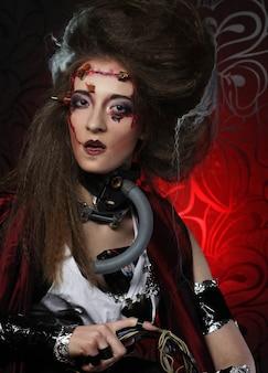 Młoda kobieta z kreatywnym makijażem. motyw halloween. motyw zombie.