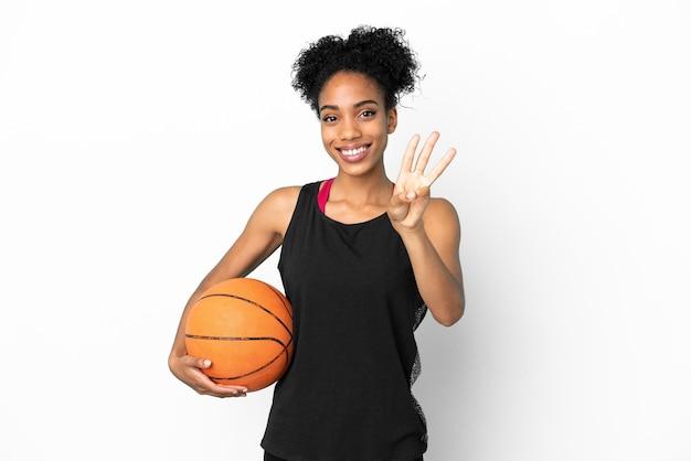 Młoda koszykarz latynoska kobieta na białym tle szczęśliwa i licząca trzy palcami