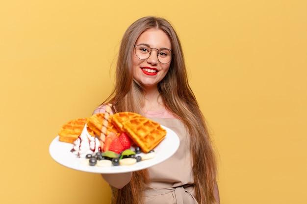 Młoda ładna kobieta. szczęśliwa i zdziwiona koncepcja piekarza ekspresowego