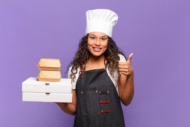 Młoda ładna Latynoska Kobieta. Szczęśliwa I Zdziwiona Koncepcja Szefa Kuchni Z Grilla Premium Zdjęcia