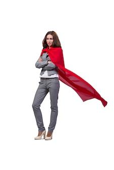 Młoda superwoman odizolowywająca na bielu