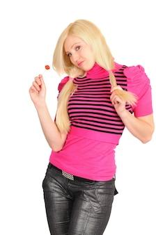 Młody atrakcyjny student dziewczyna w jasne ubrania z cukierkami, pozowanie na białym tle