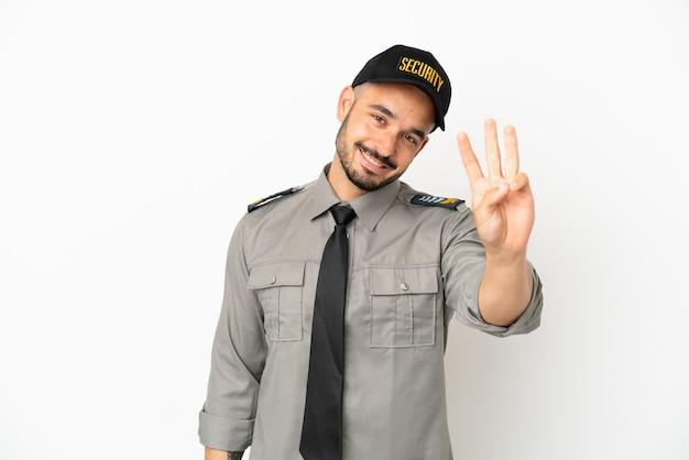 Młody bezpieczeństwa kaukaski mężczyzna na białym tle szczęśliwy i liczący trzy palcami