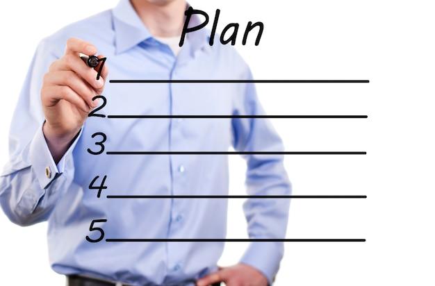 Młody biznesmen planu działania