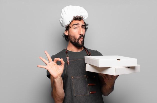 Młody brodaty mężczyzna. koncepcja szefa kuchni pizzy