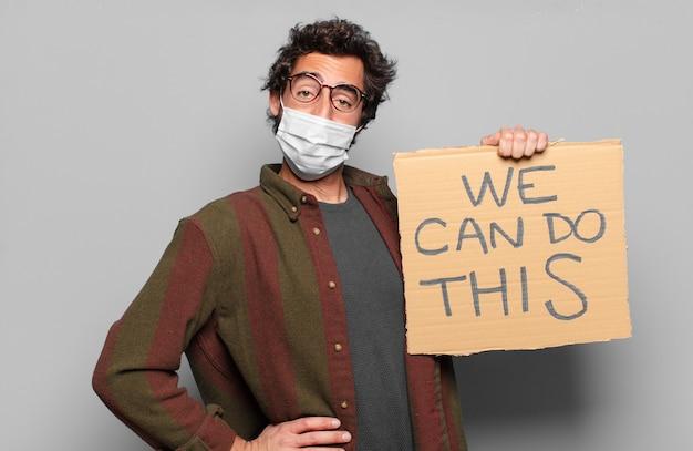 Młody brodaty mężczyzna w masce medycznej i możemy zrobić tę koncepcję