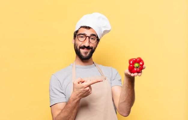 Młody brodaty mężczyzna wskazujący lub pokazujący szefa kuchni