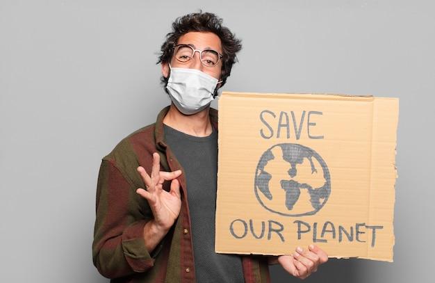 Młody brodaty mężczyzna z maską medyczną. ocal naszą koncepcję planety