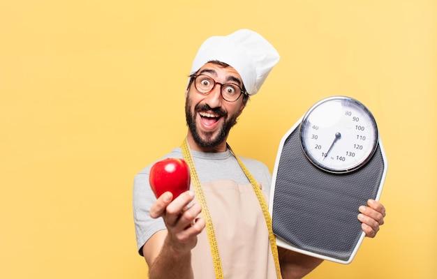 Młody brodaty szef kuchni zaskoczony wyrazem