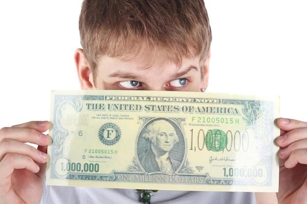 Młody chłopak z banknotem miliona dolarów, koncepcja czarnego piątku