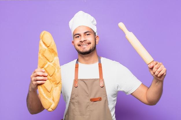 Młody człowiek hiszpanin szczęśliwy wypowiedzi. koncepcja szefa kuchni lub piekarza