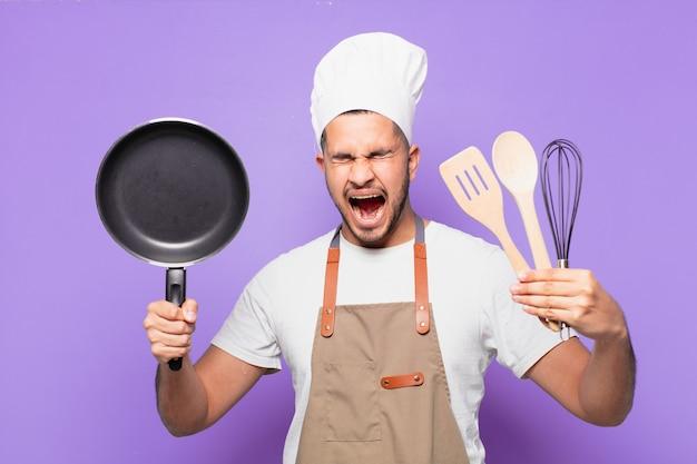 Młody człowiek hiszpanin zły wyraz. koncepcja szefa kuchni