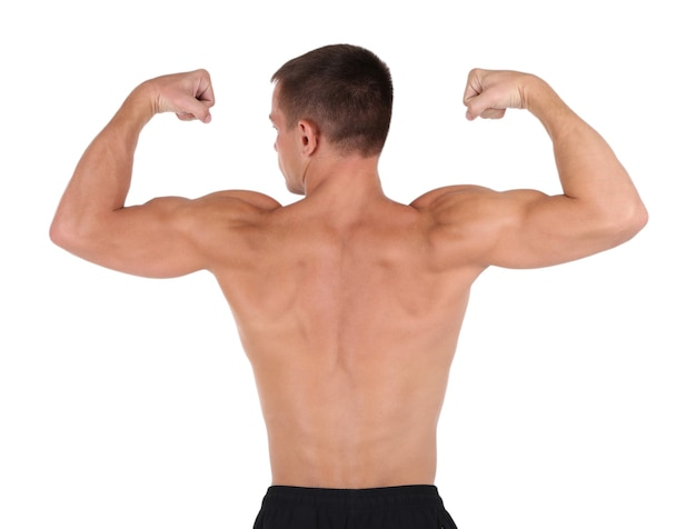Młody człowiek mięśni na białym tle