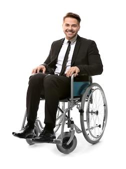 Młody człowiek na wózku inwalidzkim na białym tle