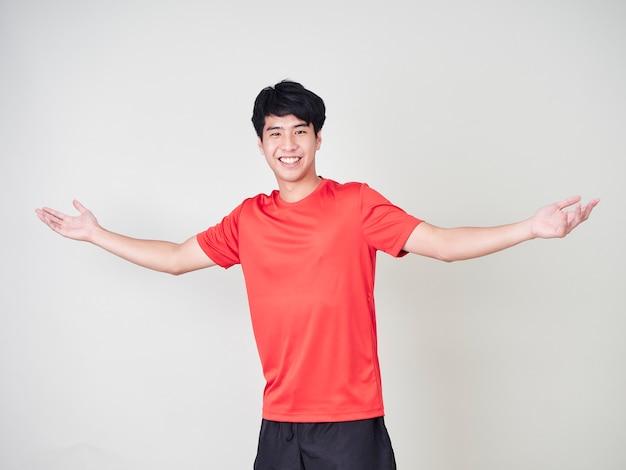 Młody człowiek sportowca gracz rozciąganie i ćwiczenia