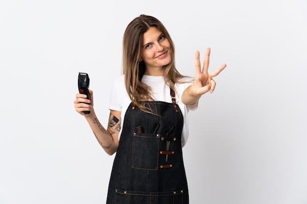 Młody fryzjer słowacka kobieta na białym tle na biały szczęśliwa i licząc trzy palcami