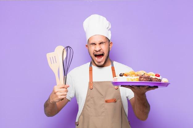 Młody hiszpanin zły koncept piekarza lub szefa kuchni