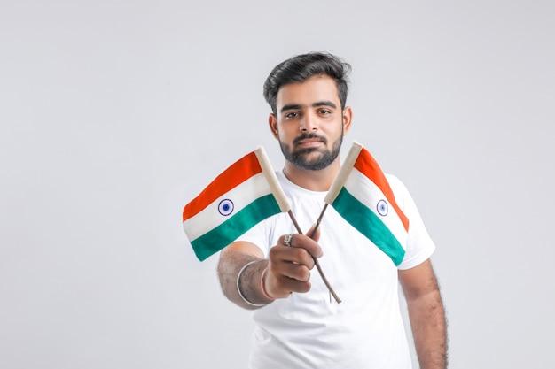 Młody indyjski student collegu z indianin flaga.
