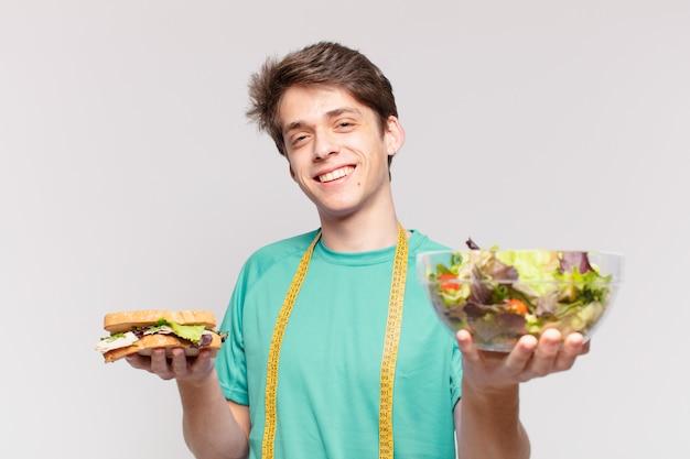 Młody nastolatek człowiek szczęśliwy wyrażenie. koncepcja diety