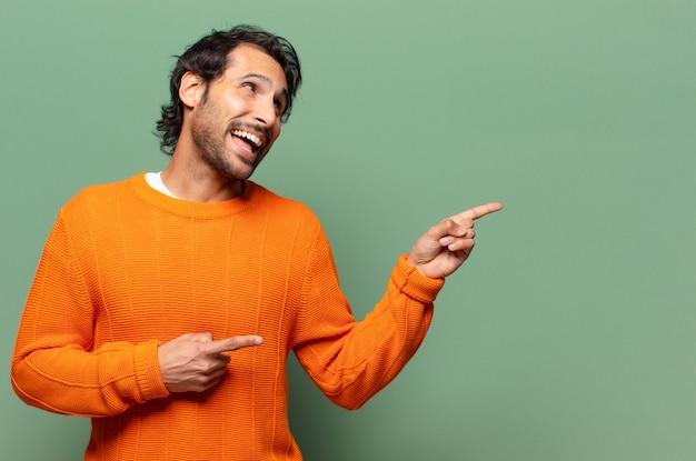 Młody przystojny ekspresyjny indyjski mężczyzna
