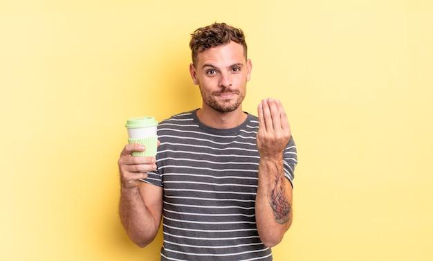 Młody przystojny mężczyzna wykonujący gest kaprysu lub pieniędzy, mówiący ci, aby zapłacić koncepcję na wynos
