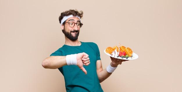 Młody sportowy mężczyzna z goframi. pojęcie diety