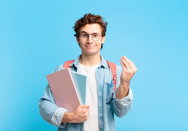 Młody student robi gest kaprysu lub pieniędzy, każąc spłacić długi!