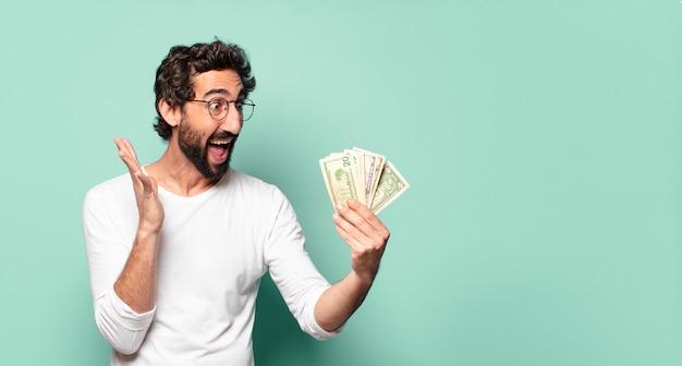 Młody szalony brodaty mężczyzna z banknotów dolara