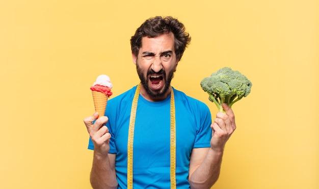 Młody szalony brodaty sportowiec zły wyraz twarzy i koncepcja diety