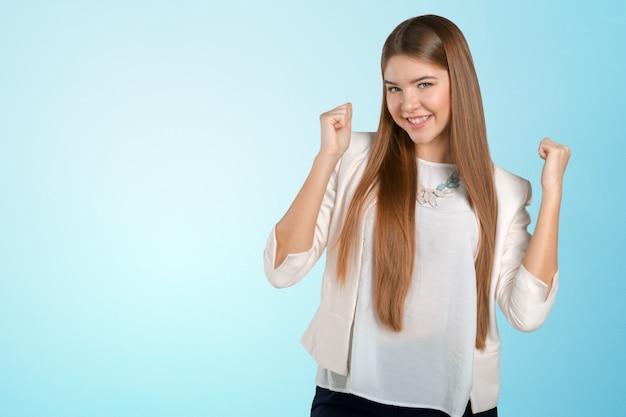 Młody szczęśliwy bizneswoman z rękami up