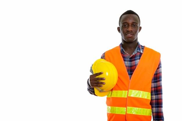Młody szczęśliwy czarny człowiek afryki pracownik budowlany