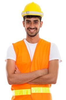 Młody szczęśliwy człowiek perski pracownik budowlany uśmiechnięty z bronią cr