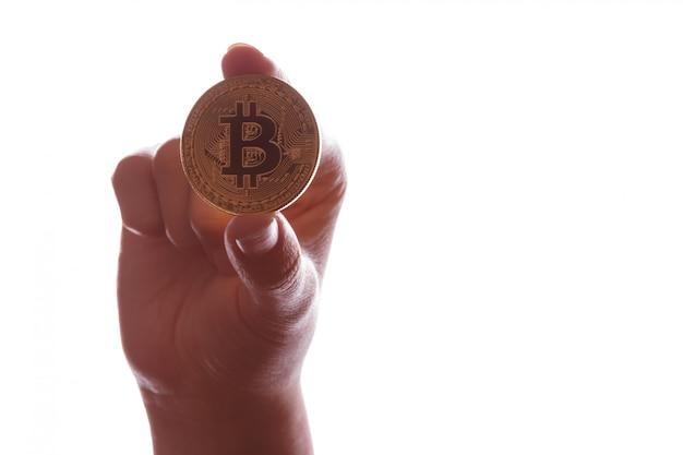 Moneta bitcoin btc w ręku